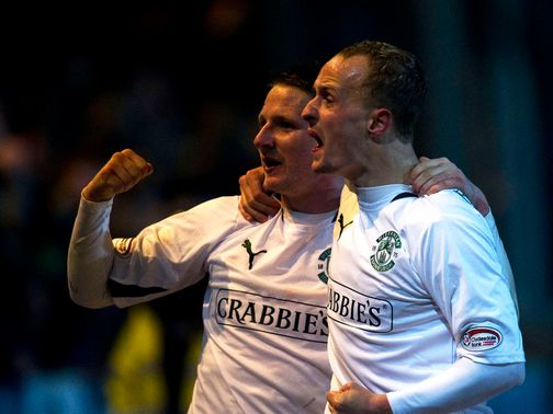 Paul Cairney and Leigh Griffiths celebrate for Hibs