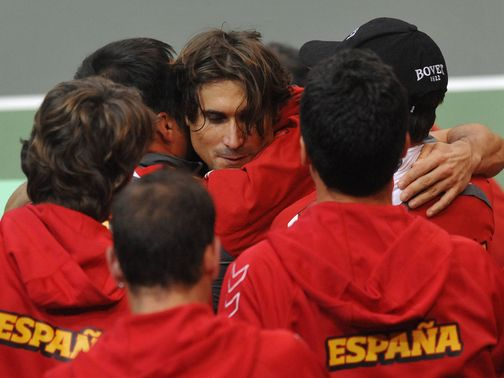 David Ferrer celebrates winning the opening rubber
