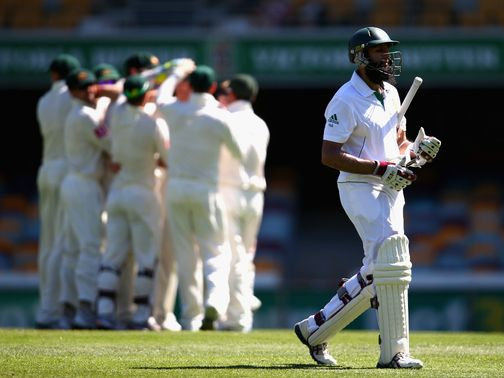 Hashim Amla walks off after he is dismissed for 38