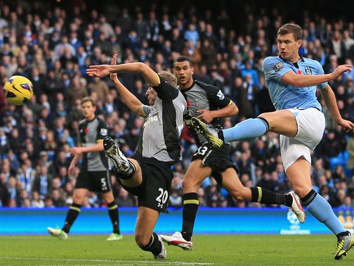 Edin Dzeko nets the winner for Man City