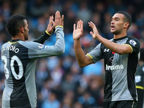 Steven Caulker (r): Made his Spurs debut against Arsenal