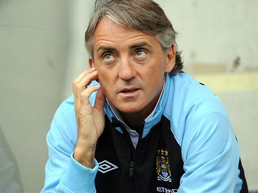 Roberto Mancini: Under pressure ahead of Manchester derby