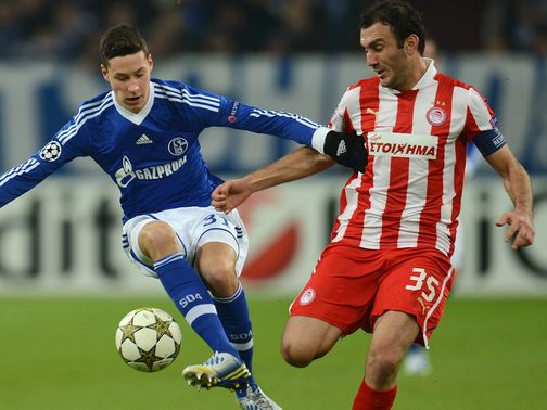 Julian Draxler battles with Vassilis Trossidis