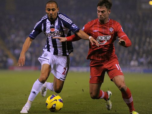 Peter Odemwingie takes on Danny Fox