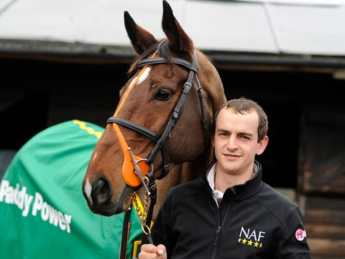 Hunt Ball poses with trainer Kieran Burke