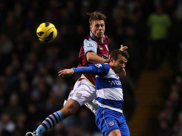 Nathan Baker and Adam Le Fondre go for a high ball