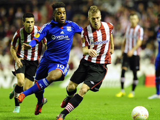 Alexandre Lacazette and Iker Muniain battle for the ball