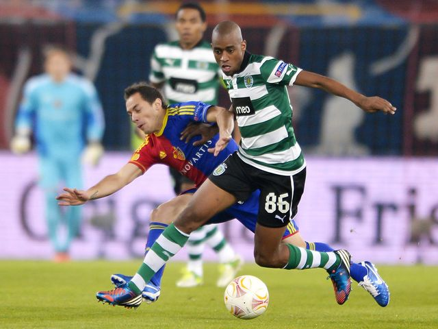 Marcelo Diaz and Gelson Fernandes battle for the ball