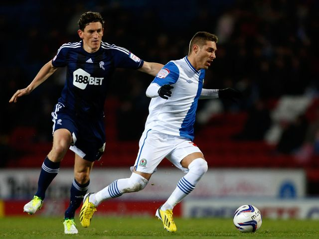 Keith Andrews and Ruben Rochina battle for the ball