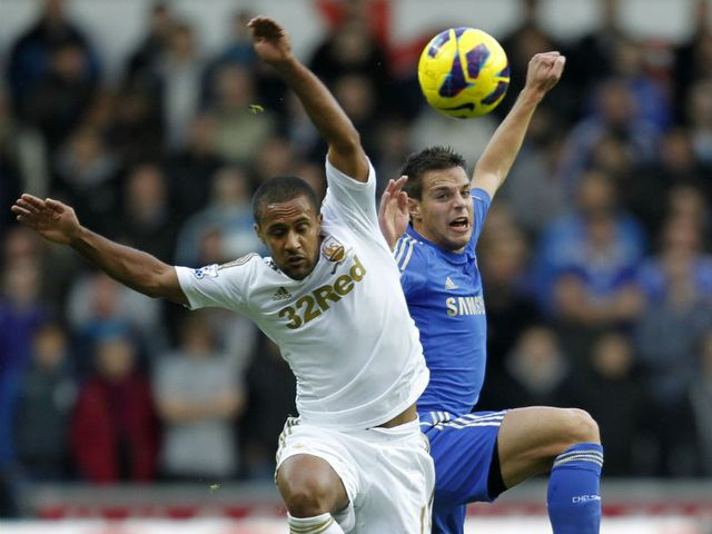Wayne Routledge and Cesar Azpilicueta battle for the ball
