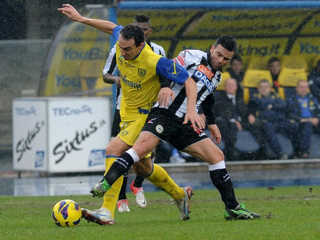 Dario Dainelli gets away from Antonio Di Natale