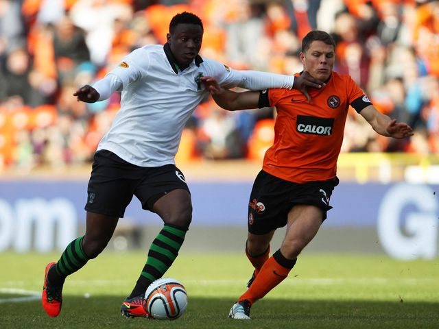 Victor Wanyama takes on John Rankin