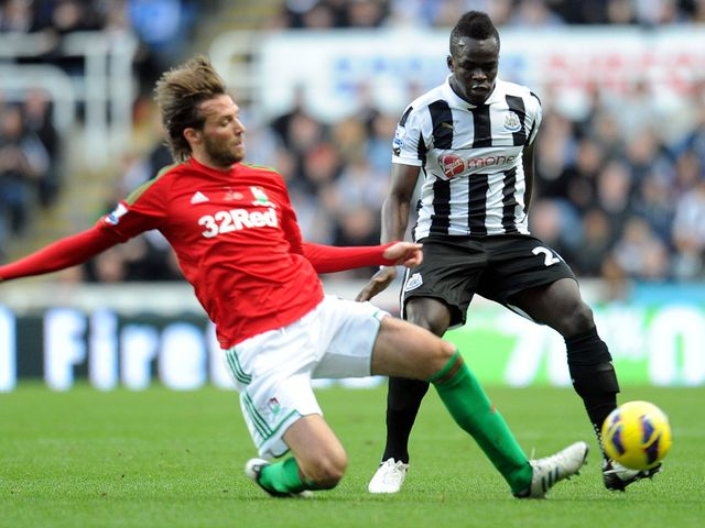 Miguel Michu slides in to tackle Cheick Tiote