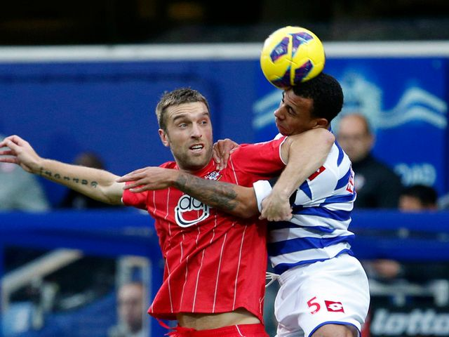 Rickie Lambert and Anton Ferdinand battle for the ball