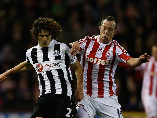 Fabricio Coloccini and Charlie Adam battle for the ball