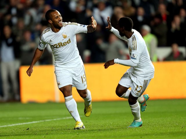 Wayne Routledge celebrates for Swansea