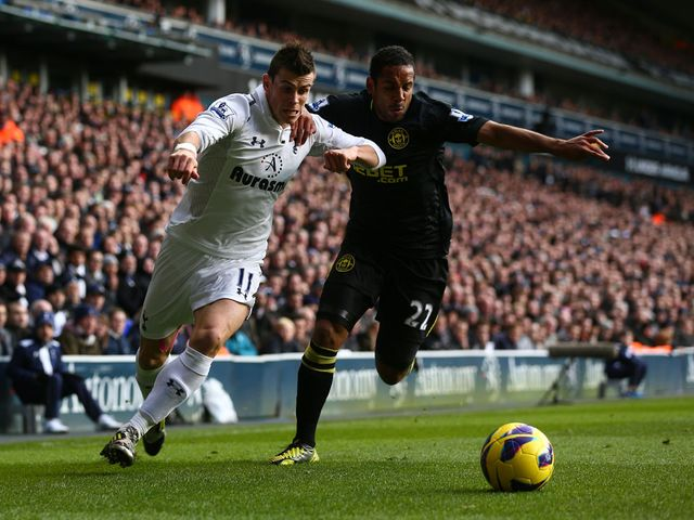 Gareth Bale and Ivan Ramis battle for the ball