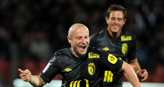 Florent Balmont celebrates after doubling Lille's lead