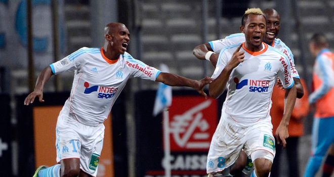 Jordan Ayew (r) celebrates his winning goal