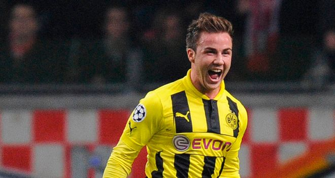 Mario Gotze celebrates after finding the net against Ajax