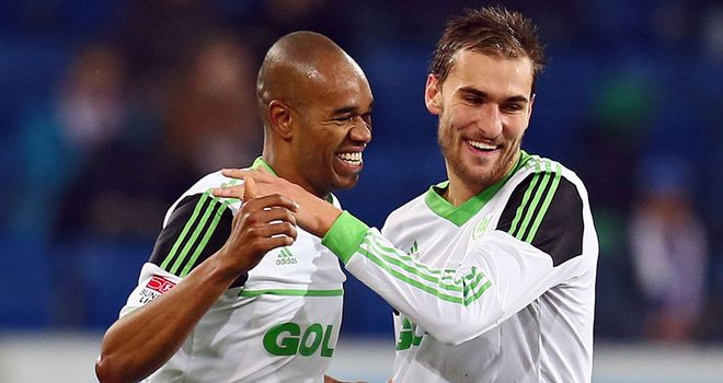 Naldo (l) celebrates with Wolfsburg team-mate Bas Dost