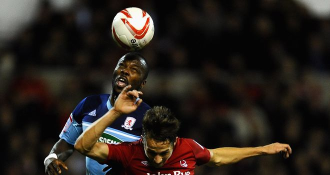 Battle: Boro's Andre Bikey and Forest's Chris Cohen vie for the ball