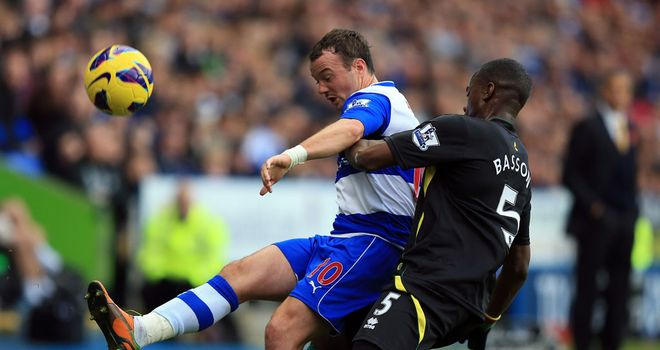 Noel Hunt battles with Sebastien Bassong in the meeting at the Madejski Stadium