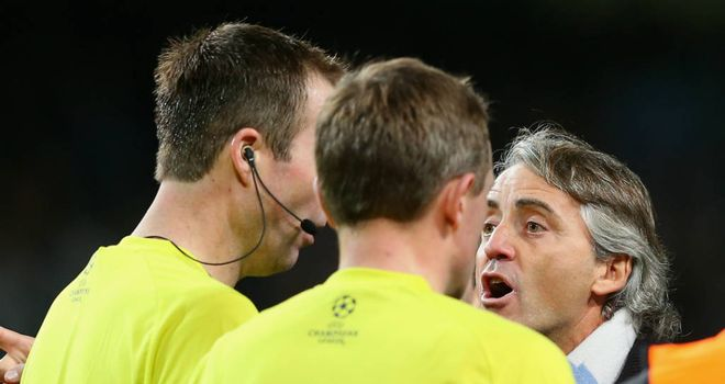 Roberto Mancini: Confronts the officials at the end of the game
