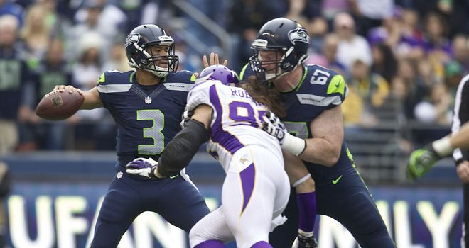 Russell Wilson: Threw three touchdown passes in Seattle's win over Minnesota