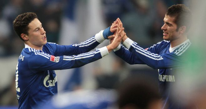 Julian Draxler (left) scored the winner for the hosts