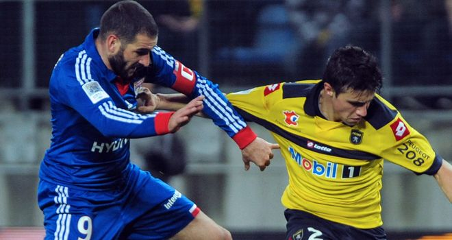 Lisandro Lopez battles with Sebastien Corchia