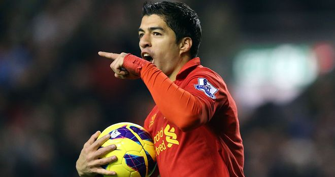 Luis Suarez celebrates claiming Liverpool's second-half equaliser