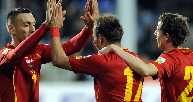 Top spot: Montenegro celebrate their third goal against San Marino