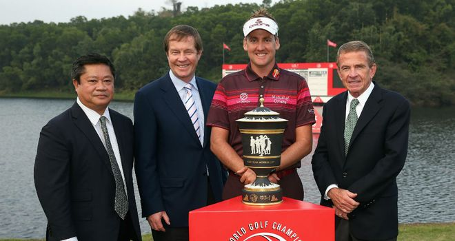 Ian Poulter poses with Tour chiefs George O'Grady (L) and Tim Finchem (R) after his triumph in China