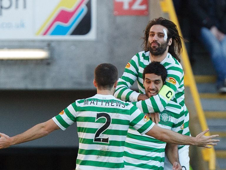 Lassad Nouioui celebrates for Celtic