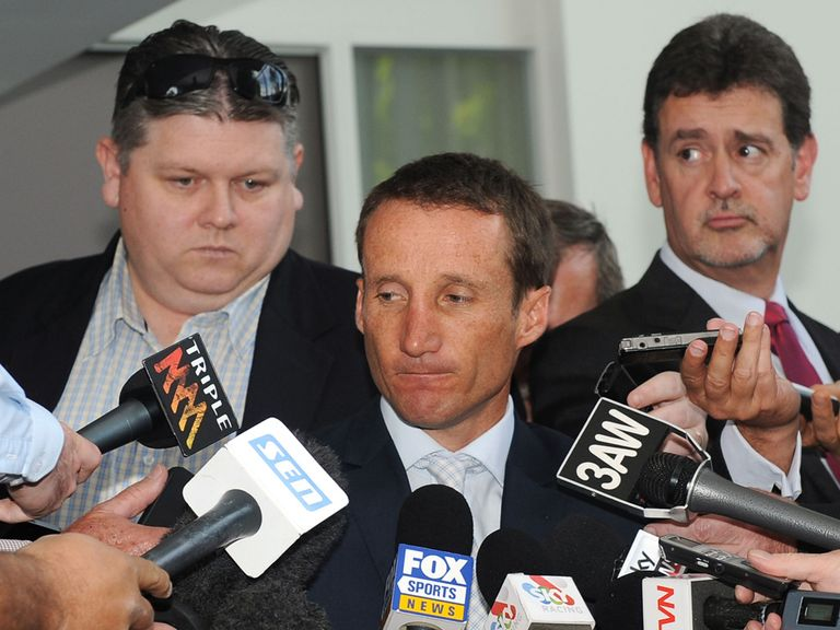 Damien Oliver faces the press after his hearing.