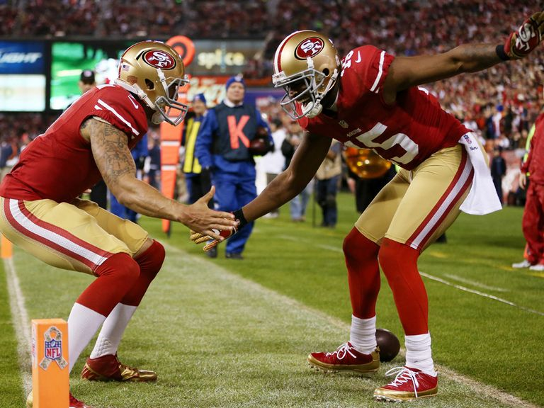 Colin Kaepernick and Michael Crabtree celebrate.