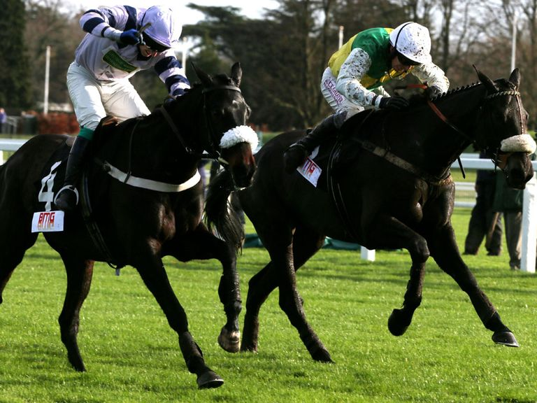 Many Clouds (right) battles to victory in the opener