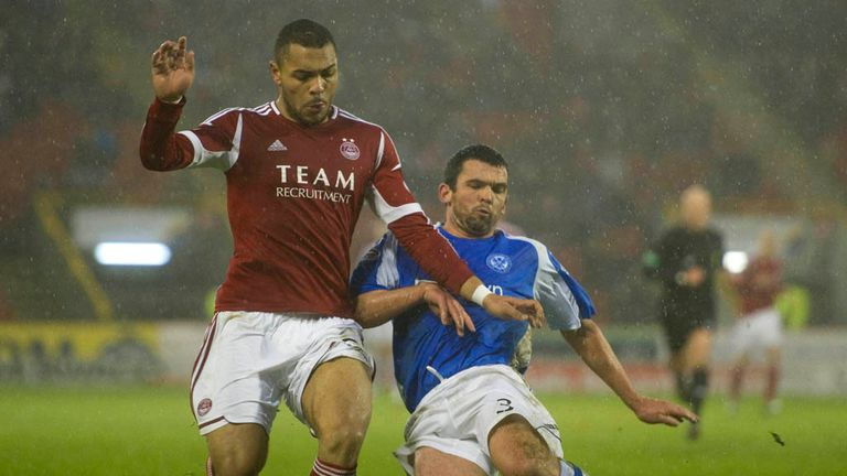 Magennis and Davidson: Battle for the ball