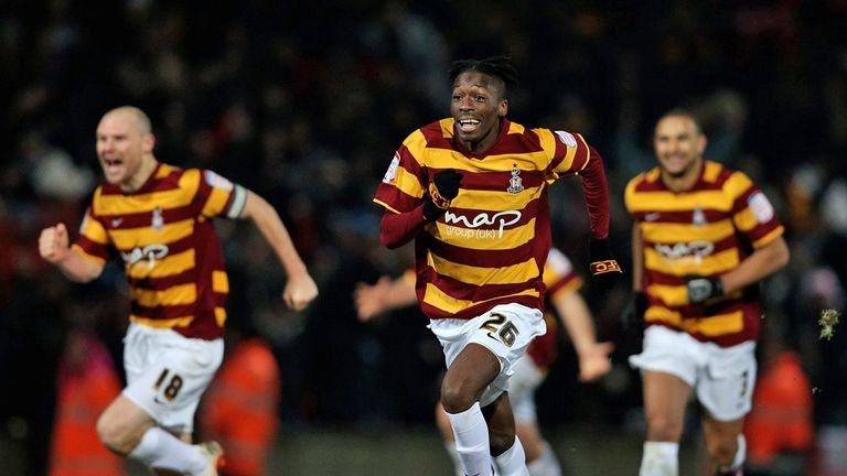 Bradford's players celebrate knocking Arsenal out at the quarter-final stage on penalties