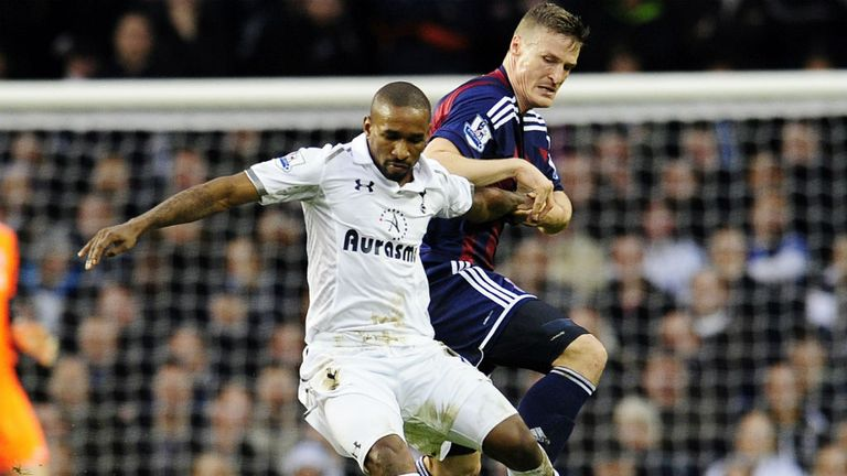 Jermain Defoe battles with Robert Huth in a tight first half