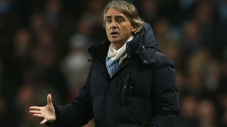 Roberto Mancini: Confident of reining in rivals Manchester United