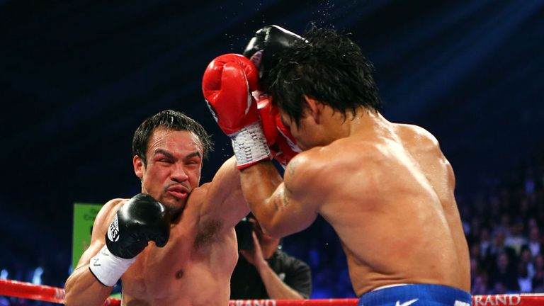 Marquez (left) defeated Pacquiao in their fifth clash in Las Vegas on Saturday