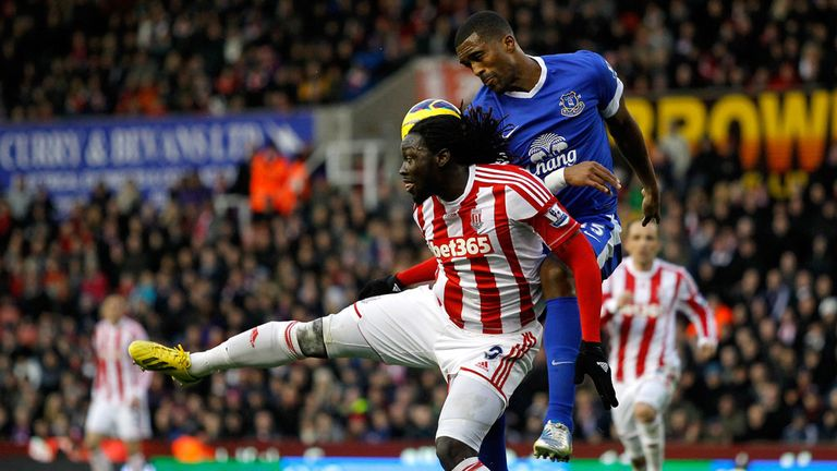 Everton defender Sylvain Distin does battle with Stoke's Kenwyne Jones