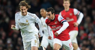 Michu (l): Tracks Arsenal's Cazorla