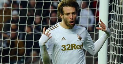 Michu: Linked with move but insists he is happy in Swansea