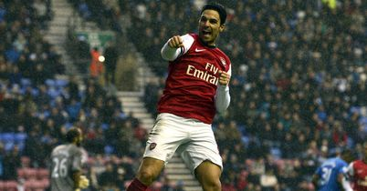Mikel Arteta celebrates at the DW Stadium