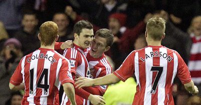 Adam Johnson: Celebrates winner against former club