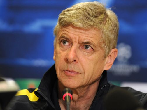Arsene Wenger faces the press on Monday.