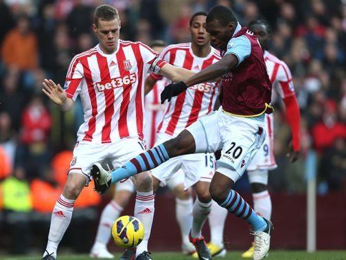 Ryan Shawcross competes with Christian Benteke